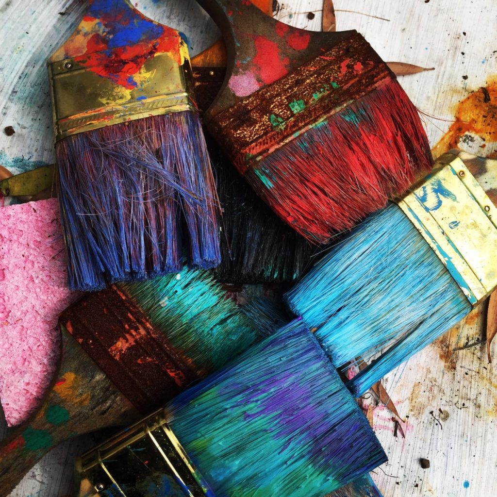 Paintbrushes covered in paint