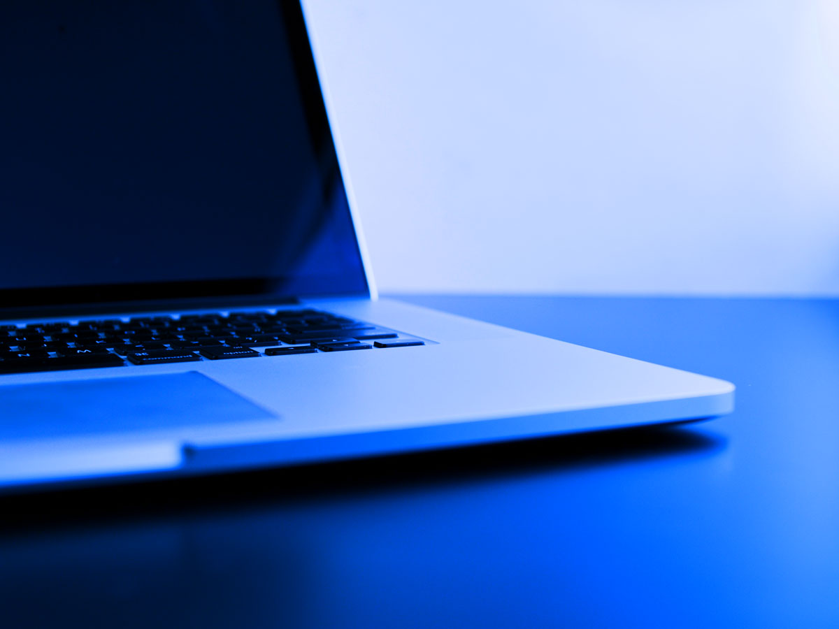 Apple laptop with blue overlay